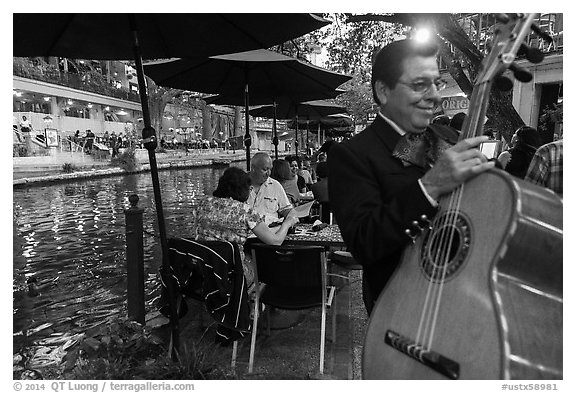 Musician on Riverwalk. San Antonio, Texas, USA (black and white)