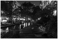 Waterfall at dusk, Riverwalk. San Antonio, Texas, USA ( black and white)