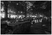 Barge and walkway at dusk, Riverwalk. San Antonio, Texas, USA ( black and white)