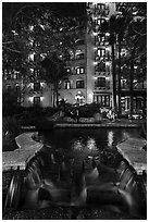 Waterfall, elegant couple in distance. San Antonio, Texas, USA ( black and white)