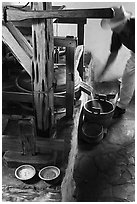 Man operating mill, Mission San Jose. San Antonio, Texas, USA ( black and white)