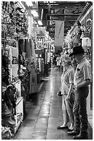Man with cowboy hat and woman look at crafts, Market Square. San Antonio, Texas, USA ( black and white)