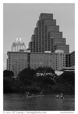 Water bicycles on Austin Lake at dusk. Austin, Texas, USA (black and white)