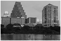 Water pedaling in front of skyline at dusk. Austin, Texas, USA ( black and white)