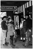 Group in front of White Elephant bar. Fort Worth, Texas, USA ( black and white)