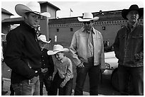 Family wearing cowboy hats, Stockyards. Fort Worth, Texas, USA ( black and white)