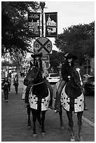 Women riding horses on sidewalk, Stockyards. Fort Worth, Texas, USA ( black and white)