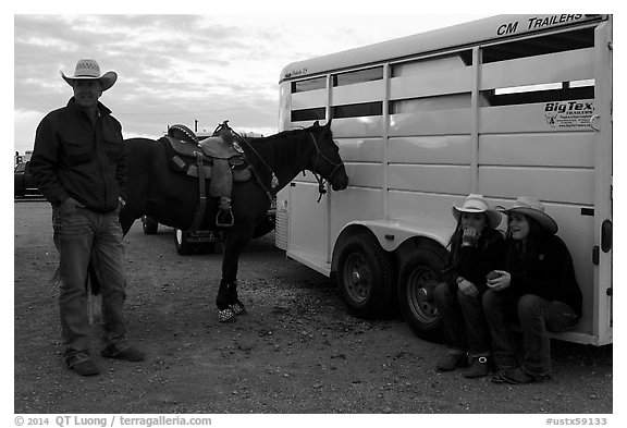 Group talking next to horse and trailer. Fort Worth, Texas, USA (black and white)