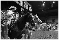 Men riding horses holding lassos. Fort Worth, Texas, USA ( black and white)