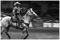 Rodeo contestant riding horse. Fort Worth, Texas, USA ( black and white)