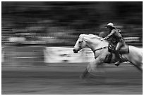 Woman on galloping horse, Stokyards Championship Rodeo. Fort Worth, Texas, USA ( black and white)