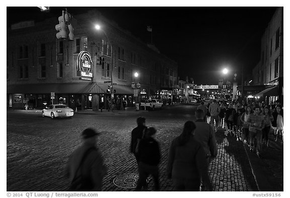 Street crossing at night, Fort Worth Stockyards. Fort Worth, Texas, USA (black and white)