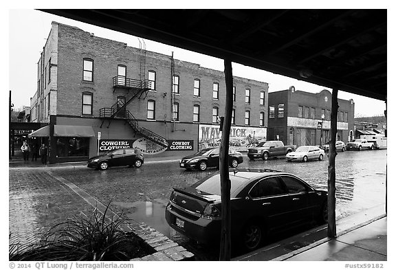 Historic buildings in the rain, Stockyards. Fort Worth, Texas, USA (black and white)