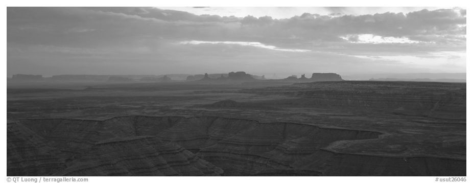 Sunset over canyon and distant mesas. Monument Valley Tribal Park, Navajo Nation, Arizona and Utah, USA (black and white)