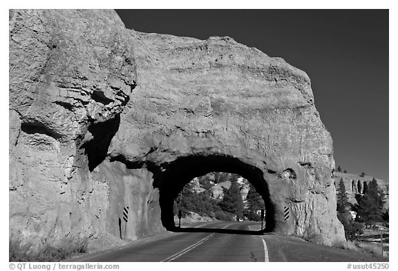 Road tunnel in pink limestone cliff. Utah, USA