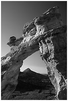 Grosvenor Arch framing peak. Grand Staircase Escalante National Monument, Utah, USA ( black and white)
