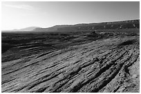 Sandstone slickrock, Straight Cliffs, and Navajo Mountain. Grand Staircase Escalante National Monument, Utah, USA ( black and white)