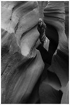 Man inside Peek-a-Boo slot canyon. Grand Staircase Escalante National Monument, Utah, USA ( black and white)