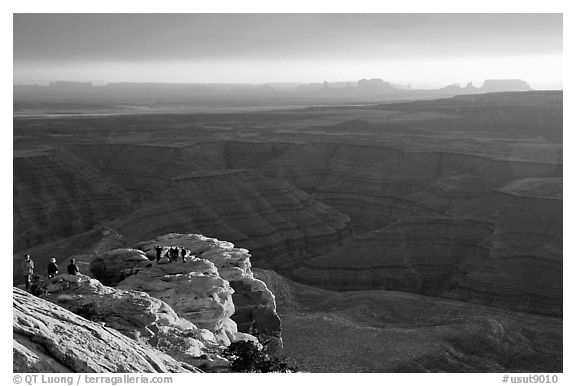 Watching the sunset over the San Juan River, Monument Valley in the background. Bears Ears National Monument, Utah, USA (black and white)