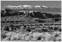 Sandstone cliffs and Henry mountains. Utah, USA ( black and white)