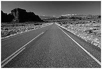 Road, sandstone cliffs, snowy mountains. Utah, USA ( black and white)