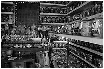 Temple room containing funeral urns with ashes of the deceased. Ho Chi Minh City, Vietnam ( black and white)