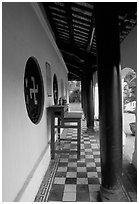 Gallery outside Giac Vien Pagoda with svastikas, district 11. Ho Chi Minh City, Vietnam ( black and white)