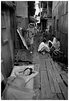 Sleeping late in a narrow alley. Ho Chi Minh City, Vietnam ( black and white)