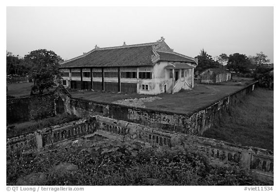 Building amongst gardens, Hue citadel. Hue, Vietnam (black and white)