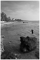Child jumping in water, Duong Dong. Phu Quoc Island, Vietnam (black and white)