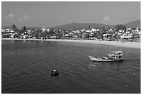 Basket boat, fishing boat, and beach, Duong Dong. Phu Quoc Island, Vietnam (black and white)