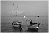 Fisherman on skiff. Phu Quoc Island, Vietnam (black and white)