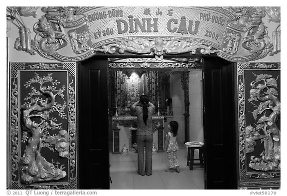 Woman with girl worshipping at Dinh Cau temple, Duong Dong. Phu Quoc Island, Vietnam (black and white)