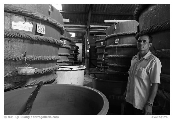 Worker in fish sauch factory, Duong Dong. Phu Quoc Island, Vietnam (black and white)