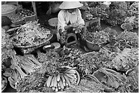 Woman selling vegetables at public market, Duong Dong. Phu Quoc Island, Vietnam (black and white)