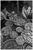 Customer purchasing fish at market, Duong Dong. Phu Quoc Island, Vietnam (black and white)