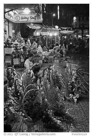 Flower and vegetable stores at night. Ho Chi Minh City, Vietnam (black and white)