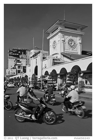 Chaotic motorcycle traffic outside Ben Thanh Market. Ho Chi Minh City, Vietnam (black and white)