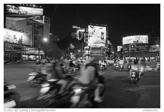 Moving traffic at night on traffic circle. Ho Chi Minh City, Vietnam (black and white)