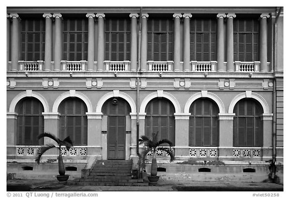 Facade of courthouse with blue doors and windows. Ho Chi Minh City, Vietnam (black and white)