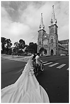 Bride with flowing dress in front of Cathedral. Ho Chi Minh City, Vietnam (black and white)