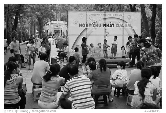Children singing, Cong Vien Van Hoa Park. Ho Chi Minh City, Vietnam (black and white)