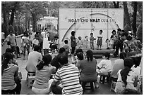 Children singing, Cong Vien Van Hoa Park. Ho Chi Minh City, Vietnam ( black and white)
