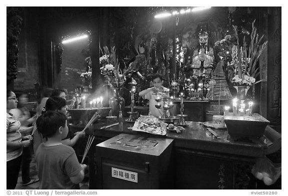 Man lightening candles, Jade Emperor Pagoda, district 3. Ho Chi Minh City, Vietnam (black and white)