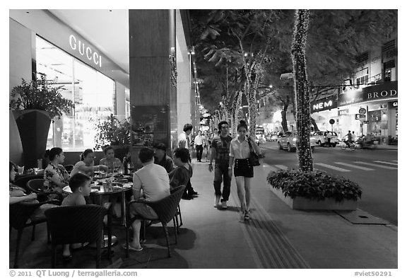 Street with luxury stores at night. Ho Chi Minh City, Vietnam (black and white)