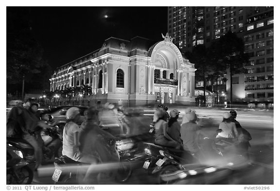 Motorbikes and colonial-area Opera House at night. Ho Chi Minh City, Vietnam (black and white)