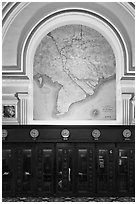 Phone booths and colonial-area map, Central Post Office. Ho Chi Minh City, Vietnam (black and white)