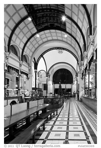 Inside of Central Post office designed by Gustave Eiffel. Ho Chi Minh City, Vietnam (black and white)