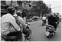 Motorcycle traffic seen from a motorcyle in motion. Ho Chi Minh City, Vietnam ( black and white)