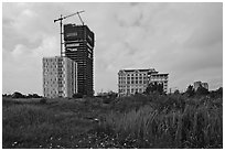 High rise towers in construction on former swampland, Phu My Hung, district 7. Ho Chi Minh City, Vietnam (black and white)